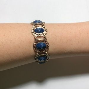 Gold bracelet with navy accents